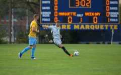 Chandler Hallwood (31) takes a free kick in Marquette's 2-0 win over UW-Green Bay Aug. 26. (Photo courtesy of Marquette Athletics.)