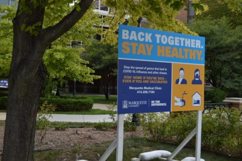 A COVID-19 health sign outside the Raynor Memorial Library.