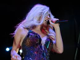 """Pictured is Kesha on her """"Warrior"""" tour in 2013."""