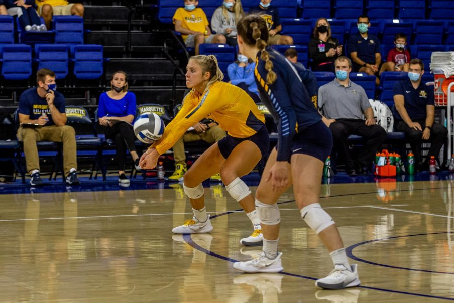 Hope Werch (8) attempts a dig in Marquettes 3-1 win over UConn Oct. 1. (Photo courtesy of Marquette Athletics.)
