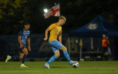 Jonas Moen (20) attempts to make a pass in Marquette mens soccers 1-0 loss to Villanova Sept. 18. (Photo courtesy of Marquette Athletics.)