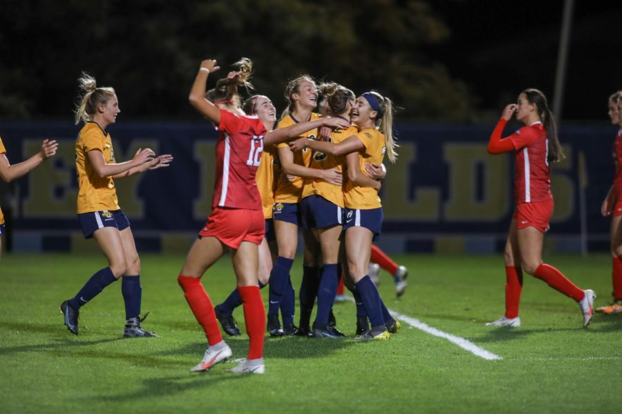 Marquette womens soccer celebrates after Katrina Wetherell scores the winning goal in overtime against St. Johns Oct. 15. (Photo courtesy of Marquette Athletics.)