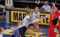 Graduate student Savannah Rennie finishes off a kill in Marquettes 3-0 win over St. Johns Oct. 15. (Photo courtesy of Marquette Athletics.)
