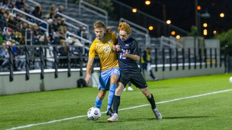 Josh Hewitt (29) takes on a DePaul defender in Marquettes 1-0 win Oct. 16. (Photo courtesy of Marquette Athletics.)