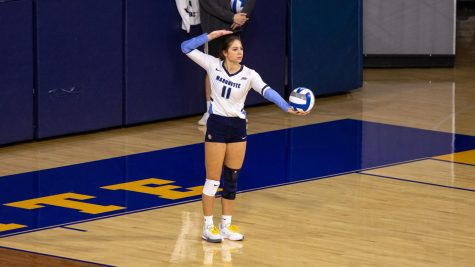 Jadyn Garrison gets ready to serve the ball in Marquettes 3-2 win over DePaul Oct. 20. (Photo courtesy of Marquette Athletics.)