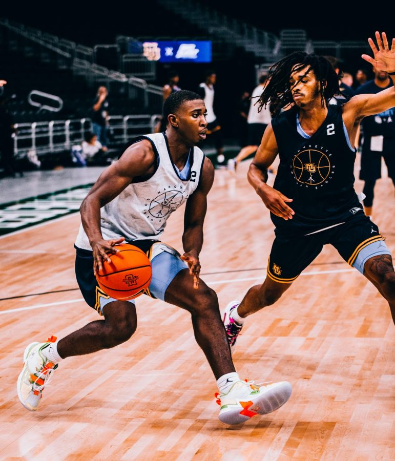 Graduate student guard Darryl Morsell (left) pulls up for a jump shot with first-year guard Emarion Ellis (right) defending Oct. 14 at Fiserv Forum.