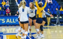 Marquette volleyball celebrates after a point in its five set victory against DePaul Oct. 20.