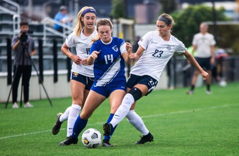 Rachel Johnson (23) and Alex Campana (19) fight for the ball in Marquettes 1-0 win over Seton Hall Oct. 3.