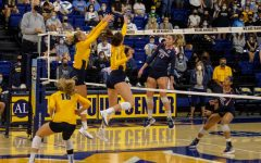 Marquette volleyball goes up for a block in its 3-1 win to UConn Oct. 1.