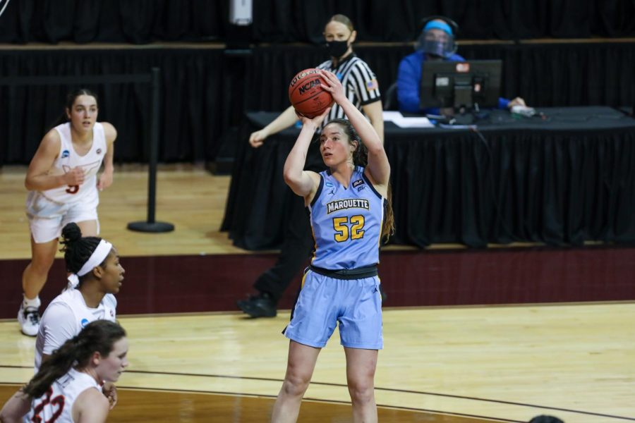 Redshirt junior forward Chloe Marotta (52) attempts a shot in Marquettes 70-63 loss to Virginia Tech March 21 in the First Round of the NCAA Tournament. (Photo courtesy of Marquette Athletics.)
