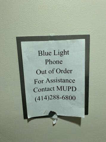 A notice listed on the fifth floor in McCabe Apartments informs residents that the Blue Light phone is out of order.